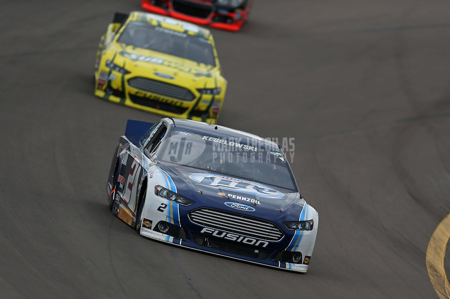 Mar. 3, 2013; Avondale, AZ, USA; NASCAR Sprint Cup Series driver Brad Keselowski leads Carl Edwards during the Subway Fresh Fit 500 at Phoenix International Raceway. Mandatory Credit: Mark J. Rebilas-