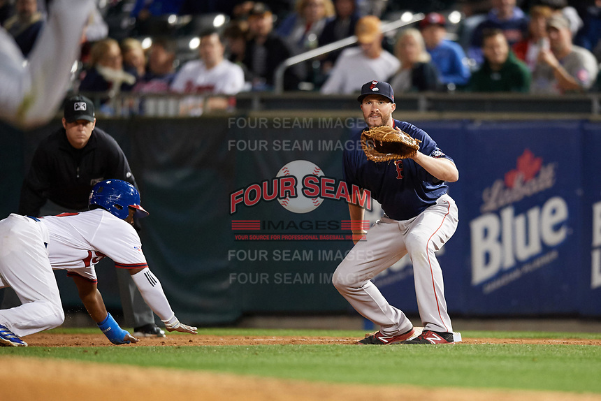 Pawtucket Red Sox first baseman Jantzen Witte (31) waits for a pickoff attempt throw as Dwight Smith Jr. (2) dives back to the bag with umpire Brian Peterson looking on during a game against the Buffalo Bisons on August 31, 2017 at Coca-Cola Field in Buffalo, New York.  Buffalo defeated Pawtucket 4-2.  (Mike Janes/Four Seam Images)