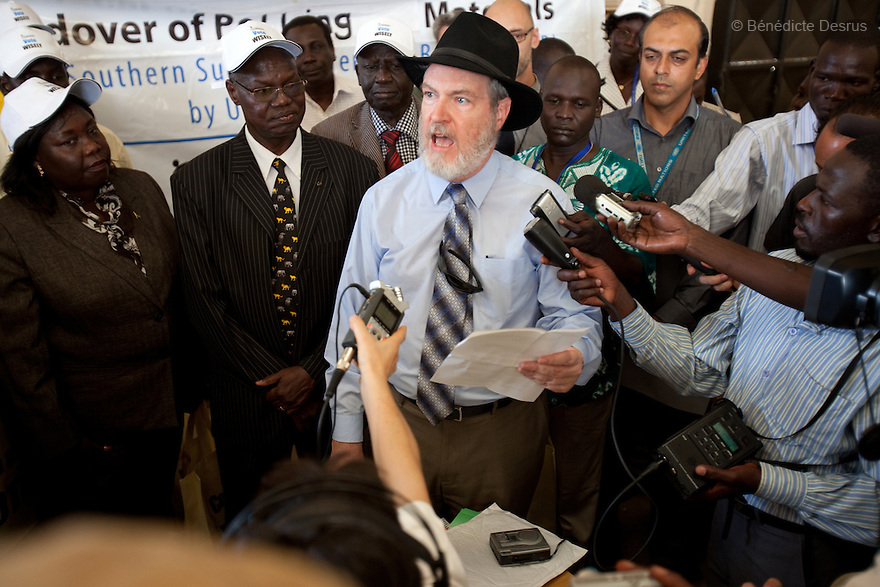 wednesday 22 december 2010 - Juba, South Sudan - Deputy US Consul General, Roger Moran, speaks to members of the Southern Sudan Referendum Bureau and the media during a handover ceremony of ballots and other referendum-related material in Juba. Moran is flanked to his right by Justice Chan Reec Madu, the Chairman of the Southern Sudan Referendum Bureau. Moran expressed US support for the southern Sudanese and the upcoming referendum, which is slated to commence on January 9, 2010. The ballots and other material will be transported to the ten states that comprise southern Sudan. The outcome of the vote will determine if the autonomous south formally secedes from the north to form the world's newest country. Photo credit: Benedicte Desrus