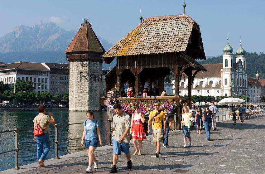 Switzerland, Canton Lucerne, City Lucerne at river Reuss: Chapel Bridge, Water Tower, Jesuit church and Pilatus mountain