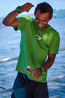 Teahupoo, Tahiti Iti, French Polynesia. Tuesday 14 August 2012. Jadson Andre (BRA) trying his hand at fishing.  The swell had backed off today to around 2' and an onshore NW wind made Teahupoo virtually unsurfable. Photo: joliphotos.com