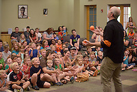 NWA Democrat-Gazette/BEN GOFF @NWABENGOFF<br /> Children watch as Galen Harp of Institute of Jugglology from Fayetteville perform on Thursday June 9, 2016 at the Bentonville Public Library. Harp and Winters won the International Jugglers Association team juggling world championship in 2014 with their act.