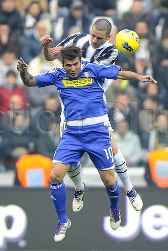 04 12 2011 Turin, Italy.  Series A Juventus versus Cesena Photo Leonardo Bonucci challenges with Adrian Mutu
