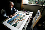 Legendary artist E.J. Hughes poses for the camera with a recently completed watercolour painting of his original Coastal Boats Near Sidney, British Columbia, which was a 1948 oil on canvas, at his home studio in Duncan, British Columbia. Photo assignment for the Globe and Mail national newspaper in Canada.