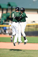 Clinton LumberKings Luis Caballero (10) jumps with Martin Peguero (7) after Peguero's game winning hit during a game against the Beloit Snappers on August 17, 2014 at Ashford University Field in Clinton, Iowa.  Clinton defeated Beloit 4-3.  (Mike Janes/Four Seam Images)