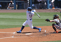 25th July 2020, Los Angeles, California, USA;  Los Angeles Dodgers infielder Max Muncy (13) gets a hit during the game against the San Francisco Giants on July 25, 2020, at Dodger Stadium in Los Angeles, CA.