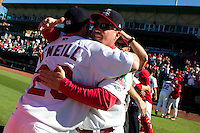 Phillip Wellman (30) of the Springfield Cardinals hugs Mike O'Neill (23) of the Springfield Cardinals after winning a game against the Tulsa Drillers at Hammons Field on September 9, 2012 in Springfield, Missouri. (David Welker/Four Seam Images)