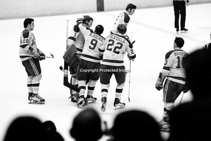 CALIFORNIA GOLDEN SEALS WIN..goalie Gary Smith is congratulated by teammates after beating the Montreal Canadiens. Ernie Hickey, Bill Hickey, Dennis Hextall, and Ted Hampton. 1971 photo (Ron Riesterer)