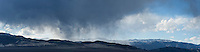 Winter rain showers over desert mountains at Eureka Valley, Death Valley national park, California