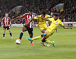 Ethan Ebanks-Landell of Sheffield United tussles with Ellis Harrison and Jake Clarke-Salter of Bristol Rovers during the EFL League One match at the Bramall Lane Stadium, Sheffield. Picture date: September 27th, 2016. Pic Jamie Tyerman/Sportimage