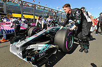 March 25, 2018: Mechanics wheel the car of Lewis Hamilton (GBR) #44 from the Mercedes AMG Petronas Motorsport team on the grid prior to the start of the 2018 Australian Formula One Grand Prix at Albert Park, Melbourne, Australia. Photo Sydney Low