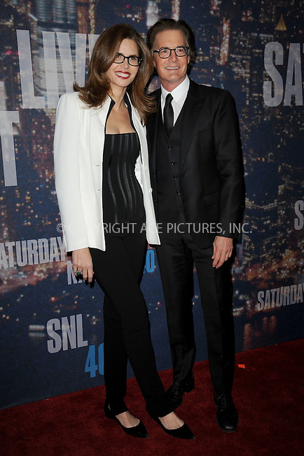 WWW.ACEPIXS.COM<br /> February 15, 2015 New York City<br /> <br /> Desiree Gruber and Kyle MacLachlan walking the red carpet at the SNL 40th Anniversary Special at 30 Rockefeller Plaza on February 15, 2015 in New York City.<br /> <br /> Please byline: Kristin Callahan/AcePictures<br /> <br /> ACEPIXS.COM<br /> <br /> Tel: (646) 769 0430<br /> e-mail: info@acepixs.com<br /> web: http://www.acepixs.com