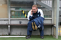 Wycombe Wanderers Coach, Richard Dobson, makes a phone call from the dug-out during Wycombe Wanderers vs Colchester United, Coca Cola League Division One Football at Adams Park on 17th October 2009