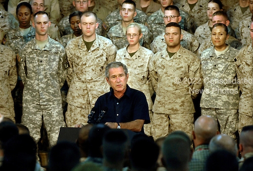 President George W. Bush speaks to U.S. Service members after meeting with the top five Iraqi Government officials and sheiks from various regions in Al Anbar Provice at Al Asad Air Base, Iraq, Sept. 3, 2007.  Bush was joined by Secretary of Defense Robert M. Gates, Secretary of State Condolezza Rice, Chairman of the Joint Chiefs of Staff Gen. Peter Pace, U.S. Central Command Commander Adm. William J. Fallon, Commander of Multinational Forces-Iraq Gen. David Petreaus, Commander of Multinational Corps-Iraq Lt. Gen. Ray Odierno, and others.  Defense Dept. photo by Cherie A. Thurlby (released)