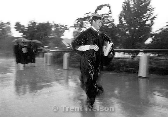 BYU graduates running to their graduation in the pouring rain.<br />