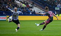 Leeds United's Kalvin Phillips (left) shoots at goal under pressure from  Sheffield Wednesday's Barry Bannan <br /> <br /> Photographer Andrew Kearns/CameraSport<br /> <br /> The EFL Sky Bet Championship - Sheffield Wednesday v Leeds United - Saturday 26th October 2019 - Hillsborough - Sheffield<br /> <br /> World Copyright © 2019 CameraSport. All rights reserved. 43 Linden Ave. Countesthorpe. Leicester. England. LE8 5PG - Tel: +44 (0) 116 277 4147 - admin@camerasport.com - www.camerasport.com