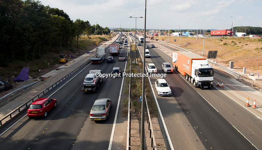 11/07/18<br /> <br /> Heavy traffic at junction 24 of the M1 between Nottingham and Derby at six o'clock - only an hour before the kick-off of England's semi final World Cup match against Croatia. <br /> <br /> All Rights Reserved, F Stop Press Ltd. (0)1335 344240 +44 (0)7765 242650  www.fstoppress.com rod@fstoppress.com