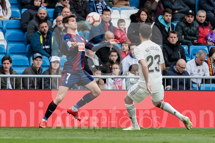 Real Madrid's Sergio Reguilon and SD Eibar's Marc Cardona during La Liga match between Real Madrid and SD Eibar at Santiago Bernabeu Stadium in Madrid, Spain.April 06, 2019. (ALTERPHOTOS/A. Perez Meca)