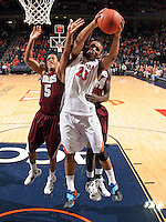 CHARLOTTESVILLE, VA- December 27: Mike Scott #23 of the Virginia Cavaliers grabs a rebound in front of Louis Bell #5 and Pina Guillaume #44 of the Maryland-Eastern Shore Hawks during the game on December 27, 2011 at the John Paul Jones Arena in Charlottesville, Va. Virginia defeated Maryland Eastern Shore 69-42.  (Photo by Andrew Shurtleff/Getty Images) *** Local Caption *** Pina Guillaume;Louis Bell;Mike Scott