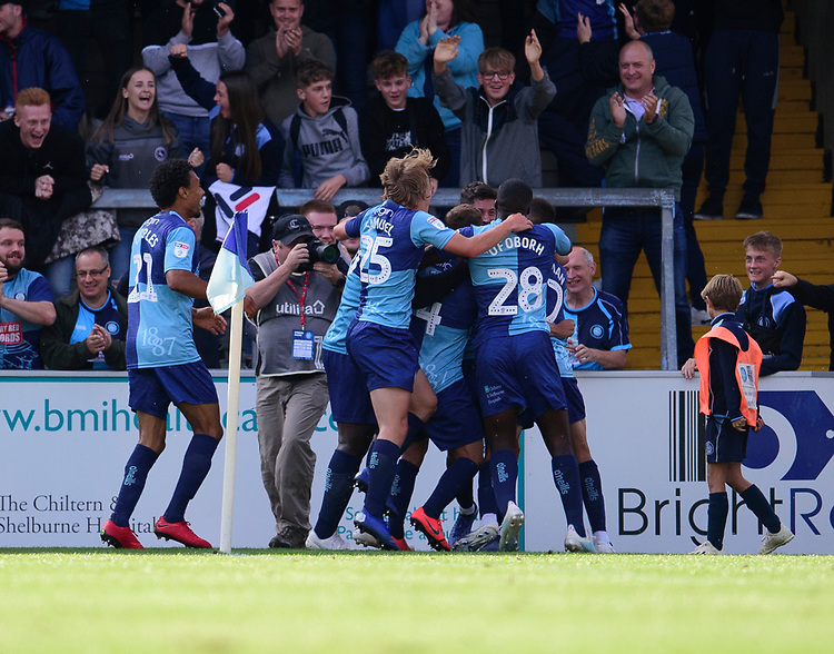Wycombe Wanderers' Joe Jacobson celebrates scoring his side's third goal with team-mates<br /> <br /> Photographer Andrew Vaughan/CameraSport<br /> <br /> The EFL Sky Bet League One - Wycombe Wanderers v Lincoln City - Saturday 7th September 2019 - Adams Park - Wycombe<br /> <br /> World Copyright © 2019 CameraSport. All rights reserved. 43 Linden Ave. Countesthorpe. Leicester. England. LE8 5PG - Tel: +44 (0) 116 277 4147 - admin@camerasport.com - www.camerasport.com