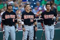 Oregon State outfielder Michael Conforto (8), second baseman Andy Peterson (14) and shortstop Tyler Smith (1) before Game 9 of the 2013 Men's College World Series against the Indiana Hoosiers on June 19, 2013 at TD Ameritrade Park in Omaha, Nebraska. The Beavers defeated the Hoosiers 1-0, eliminating Indiana from the tournament. (Andrew Woolley/Four Seam Images)