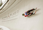 """5 December 2015: Eliza Cauce, competing for Latvia, slides through Curve 10 """"Shady"""" on her first run of the Viessmann World Cup Women's Luge at the Olympic Sports Track in Lake Placid, New York, USA. Mandatory Credit: Ed Wolfstein Photo *** RAW (NEF) Image File Available ***"""