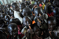KENYA, Turkana Region, refugee camp Kakuma, children after holy mass in church of Don Bosco  / KENIA Fluechtlingslager Kakuma in der Turkana Region , Kinder nach Messe in Kirche von Don Bosco