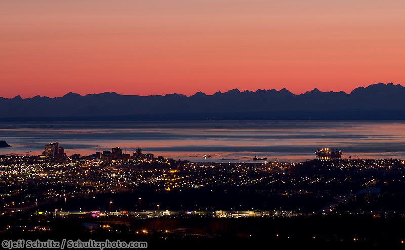 Downtown Anchorage skyline and Cook Inlet at sunset with  Aluetian Range background    April 2014<br />