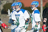 Matt Heeter,'18, center, is congratulated by teammates after scoring on Anna Maria during the Salve Regina Men's Lacrosse game at Gaudet Field.
