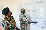 Park warden, Miriam Namushi, discussing anti-poaching strategies with her commander, Kafue National Park, Zambia