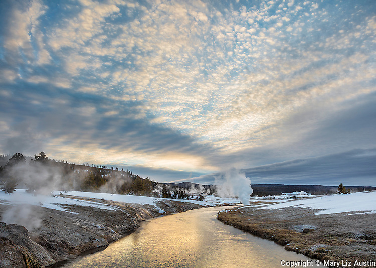 Yellowstone National Park, WY: Sunrise clouds over the Firehole River in the Upper Geyser Basin