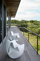 wooden balcony with lounge chairs