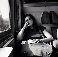 An Italian looks out the window of a passenger train in Italy taken in the summer of 2007.