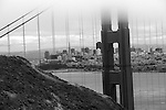 """The Gate Keeper"" Black and White Downtown San Francisco through the Golden Gate Bridge with a layer of classic fog."