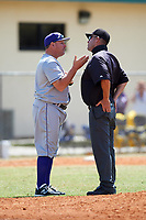 New York University Violets head coach Doug Kimbler (19) argues the ejection of first baseman Colman Hendershot (not shown) with the field umpire during a game against the Edgewood Eagles on March 14, 2017 at Terry Park in Fort Myers, Florida.  NYU defeated Edgewood 12-7.  (Mike Janes/Four Seam Images)