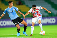 ARMENIA, COLOMBIA - JANUARY 19: Uruguay's Jose Rodriguez fight for the ball against Paraguay's Hugo Fernandez during their CONMEBOL Pre-Olympic soccer game at Centenario Stadium on January 19, 2020 in Armenia, Colombia. (Photo by Daniel Munoz/VIEW press/Getty Images)