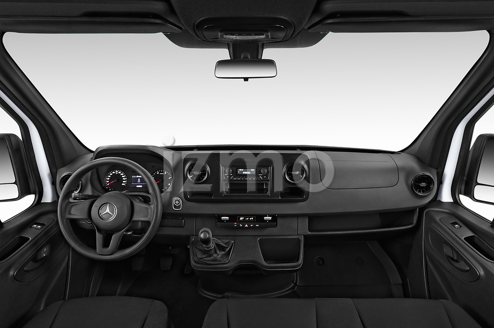 Stock photo of straight dashboard view of a 2019 Mercedes Benz Sprinter DC Base 4 Door Pick Up