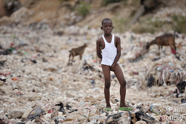 "A young boy living in a ""tent city"" of homeless earthquake survivors in the Bobin neighborhood of Port-au-Prince, Haiti. The January 2010 earthquake ravaged the capital, killing some 300,000 people and leaving more than 1.3 million homeless."