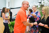 NWA Democrat-Gazette/CHARLIE KAIJO Adult Drug Court graduate Jackson Taylor receives his diploma during graduation, Friday, June 8, 2018 at the Church of Christ in Bentonville. <br /><br />Some participants in Benton County&acirc;&euro;&trade;s drug and veterans court graduated from the program, their largest class. A ceremony was held Friday and Lt. Governor Tim Griffith was the guest speaker.