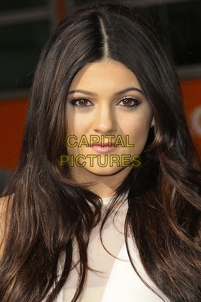 KYLIE JENNER.Los Angeles Premiere of 'Project X' at Grauman's Chinese Theatre, Hollywood, CA, USA. .February 29th, 2011 .headshot portrait white .CAP/CEL .©CelPh/Capital Pictures.