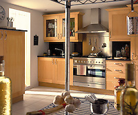 A modern kitchen with wood units and a tiled floor. A cooker hood is set above a stainless steel range oven.