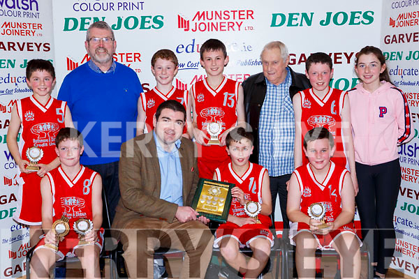 Minister Brendan Griffin presemts the trophy to  Holy Family NS 6th Rathmoreteam after winning the Senior NS A final at the St Marys Basketball Blitz on Saturday front row l-r: Ciaran Collins, Minister Brendan Griffin, Darragh Nagle, Cian Mangan. Back row: Jack buckley, Diarmuid McCarthy Principal, Fionn Murphy, Sean finnegan, Adrian Fleming, Cian Twomey, Mary Anne Fleming