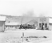 Street scene, Monero depot and general store, warehouse in left foreground. Large coal pile in background.  Second locomotive partially visable, No. 10.<br /> D&amp;RGW  Monero, NM  Taken by Krause, John