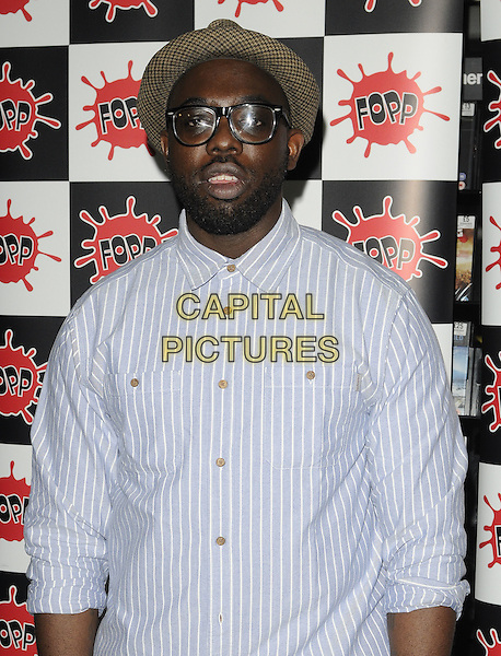 GHOSTPOET aka OBARO EJIMIWE.Ghostpoet album signing & performance, Fopp music & dvd store, Earlham St., London, England..August 22nd, 2011.half length blue stripe shirt white hat straw beard facial hair glasses .CAP/CAN.©Can Nguyen/Capital Pictures.
