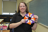 Mette Pederson, Origami designer and folder, teaches a class how to fold the modular Foil Ring she is holding