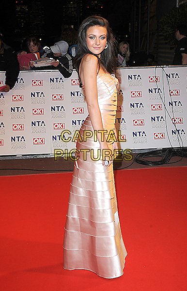 MICHELLE KEEGAN.Arrivals at the 15th National Television Awards held at the O2 Arena, London, England. .January 20th, 2010 .NTA NTAs full length maxi ruffle tiered strapless gold beige dress side .CAP/BEL.©Tom Belcher/Capital Pictures