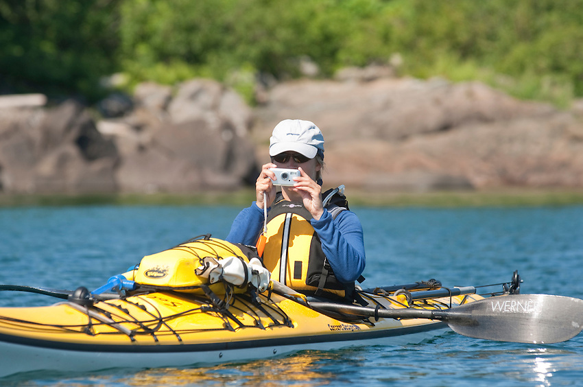 A kayaker takes photos at Isle Royale National Park.