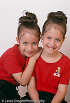 Preschool: Headstart reunion portrait of girls, 6 year old twins, closeup