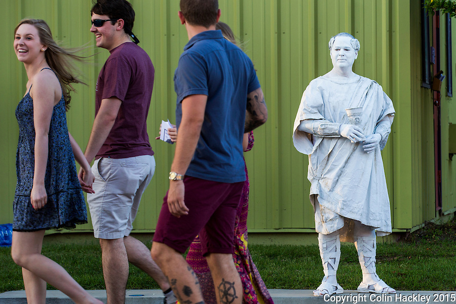 Sometimes the artwork looks back at you during First Fridays in Railroad Square. Here Paul Wilford, right, portrays Ceasar.<br /> <br /> COLIN HACKLEY PHOTO