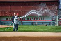 Otterbein coaches water down the filed before a baseball game.